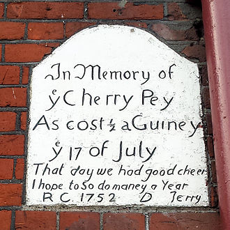 Wanstead - The plaque on the side of The George pub, commemorating a cherry pie