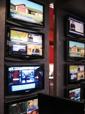 MSNBC - The monitors of the MSNBC newsroom are tuned into various global channels.