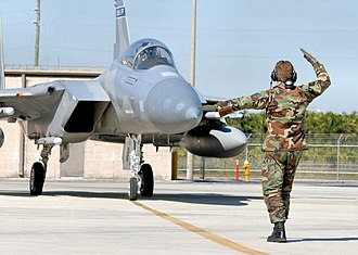 125th Fighter Wing - TSgt Aaron Hartley of the Florida Air National Guard's Det. 1, 125th Fighter Wing, guides F-15A-13-MC Eagle AF Ser. No. 75-0029 on the flightline at Homestead Air Reserve Base