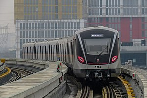 A Line 17 train departs Middle Jiasong Road station, bound for Hongqiao Railway Station station.