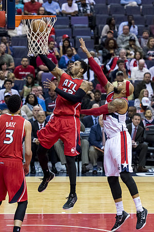 Mike Scott (basketball) - Scott (middle) with the Atlanta Hawks in April 2015