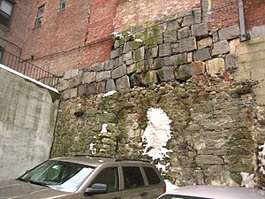Building material - This wall in Beacon Hill, Boston shows different types of brickwork and stone foundations.