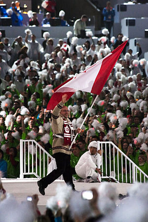 Canada at the 2010 Winter Paralympics - Flag bearer Jean Labonté, as the Canadian delegation is entering the stadium during the opening ceremony.