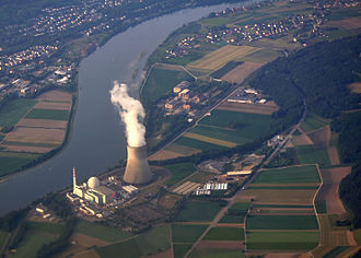 Nuclear power - The 1200 MWe Leibstadt Nuclear Power Plant in Switzerland. The boiling water reactor (BWR), located inside the dome capped cylindrical structure, is dwarfed in size by its cooling tower. The station produces a yearly average of 25 million kilowatt-hours per day, sufficient to power a city the size of Boston.