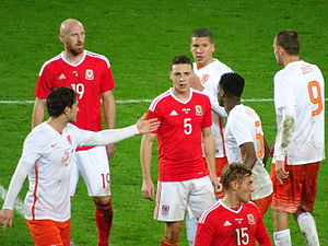 James Collins (footballer, born 1983) - Collins (wearing No.19) faces the Netherlands in 2015.