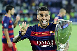 Dani Alves - Alves celebrates after winning the 2015 UEFA Super Cup with Barcelona