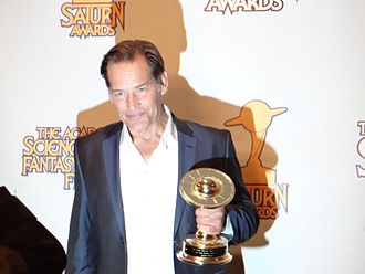Saturn Award - James Remar holding a Saturn Award at the 2011 ceremony.