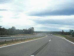 A view of dual carriage motorway following a curve