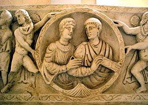 Toga - Detail, showing a portrait of the deceased couple, from the upper front side of the cast of so-called Sarcophagus of Stilicho, sculpted around 385 AD, Museum of Roman Civilization, Rome (the original sarcophagus is in Basilica of Sant'Ambrogio in Milan, Italy).