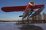 A308, Floatplane on display stand at sunset, Thompson, Manitoba, Canada, 2013.JPG