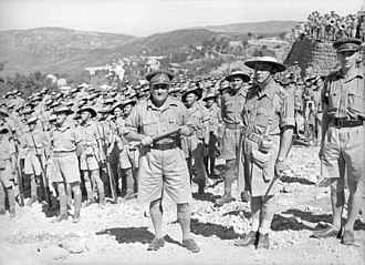 "7th Division (Australia) - Hammana, Lebanon. 2 September 1941. Maj. Gen. A. S. ""Tubby"" Allen (centre), commander of the 7th Division, with Lt Col. Murray Moten (centre right), commander of the 2/27th Infantry Battalion and his men. (Photographer: Frank Hurley.)"