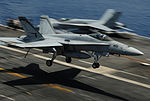 A U.S. Navy F-A-18C Hornet aircraft assigned to Strike Fighter Squadron (VFA) 94 lands on the flight deck of the aircraft carrier USS Carl Vinson (CVN 70) in the Pacific Ocean June 10, 2013 130610-N-ZP059-207.jpg