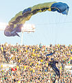 A U.S. Sailor with the Leap Frogs parachutes onto the field at Notre Dame Stadium in South Bend, Ind., Sept. 6, 2014, before a football game 140906-D-KC128-137.jpg