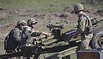 A soldier with the Ukrainian Land Forces (right), loads an 82mm mortar.jpg