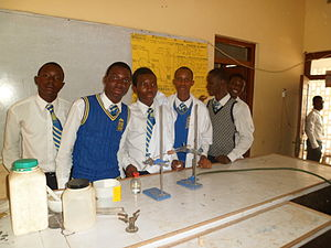 Education in Ghana - Ghana High school Students of the Accra Academy; Learning Science and undertaking Scientific tests in Science Laboratory.