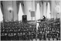 Advisors, Secretary of Defense Robert McNamara alone in meeting room - NARA - 192541.tif