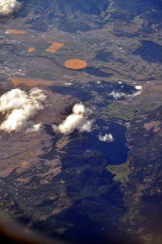 Liberty Lake, Washington - Aerial view of Liberty Lake (lake and city, 2013) from roughly south by southeast. The city is immediately north of the lake, and runs somewhat further west than the lake. The Spokane River, near the top of the photo, forms the northern border of the city.