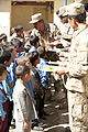 Afghan Elite Policemen Deliver School Supplies (5063716795).jpg