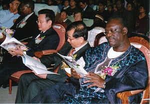 English: Distinguished delegates in attendance...