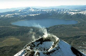 Kamchatka Peninsula - The lake-filled Akademia Nauk caldera, seen here from the north with Karymsky volcano in the foreground.