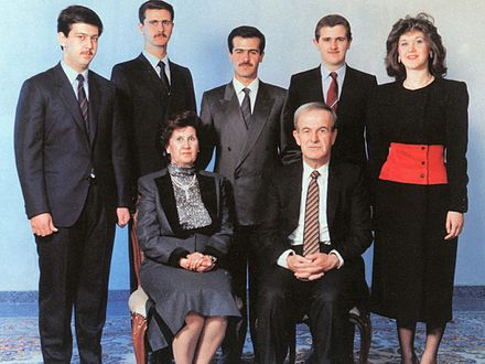 Assad and his wife, Anisa Makhlouf; back row, left to right: Maher, Bashar, Bassel, Majid and Bushra al-Assad Al Assad family.jpg