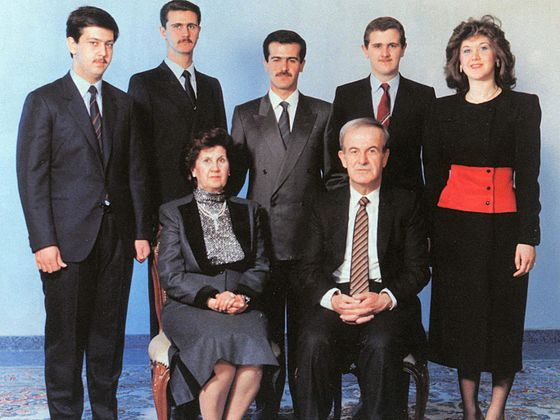 The al-Assad family, c. 1993. At the front are Hafez and his wife, Anisa. At the back row, from left to right: Maher, Bashar, Bassel, Majd, and Bushra F-assad.jpg