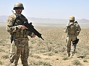 Albanian special operations forces, provide security as Afghan Border Police (ABP) break ground on a new checkpoint in the district of Spin Boldak, Kandahar province, Afghanistan, March 25, 2013 130325-A-MX357-127