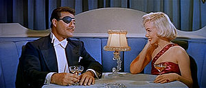 Alexander D'Arcy and Marilyn Monroe in How to Marry a Millionaire trailer.jpg
