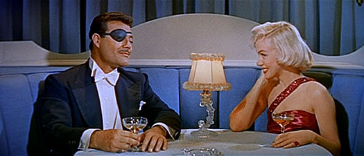 Pola being romanced by a phony tycoon, played by Alexander D'Arcy Alexander D'Arcy and Marilyn Monroe in How to Marry a Millionaire trailer.jpg