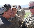 Amanullah Khan, left, the governor of Uruzgan province, and U.S. Army Maj. Gen. Paul J. LaCamera, the commanding general of Regional Command South and the 4th Infantry Division, talk in Deh Rahwod district 140324-A-MH103-457.jpg