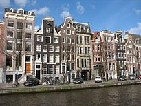 Row of houses with the relatively tall buildings typical of Amsterdam