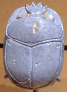 object in the form of a scarab beetle in art