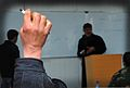 An Afghan National Police (ANP) student raises his hand to answer a question during a basic Dari course at the ANP Training Center supported by the South Korea Provincial Reconstruction Team for Parwan province 120127-N-VN372-026.jpg