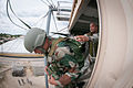 An Indian Army paratrooper jumps from a 34-foot parachute training tower with help from U.S. Army Sgt. 1st Class Garrett Williams.jpg