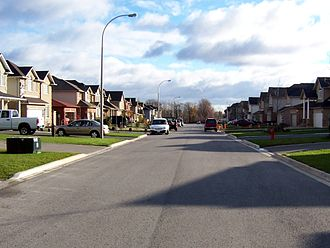 Effects of the car on societies - A street without a sidewalk, where the pedestrian must walk on the road pavement.