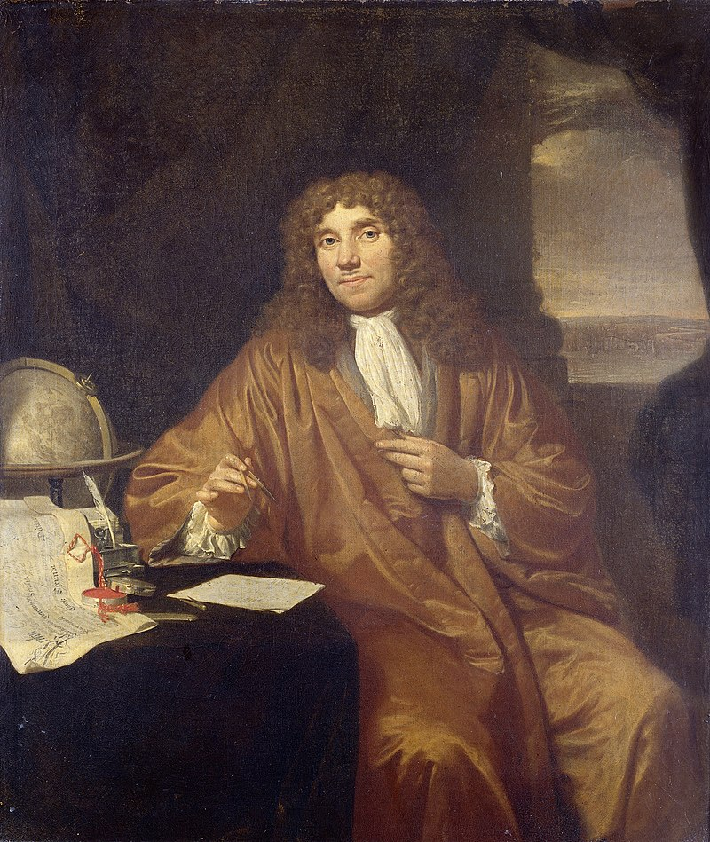 painting of Antonie van Leeuwenhoek, in robe and frilled shirt, with ink pen and paper