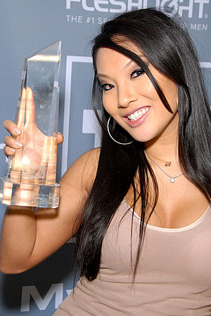 Asa Akira - Akira holding her 2012 XBIZ Award for Female Performer of the Year backstage at the award ceremony.