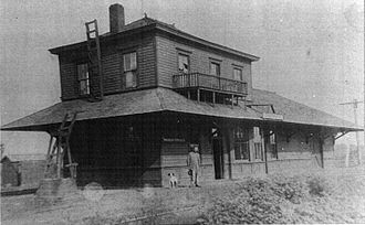 Asher, Oklahoma - Rock Island Train Depot, Asher OK - 1902. The station was located at the west end of Main ST, west of what is now US 177. The Stationmaster, Bill Bailey, is pictured.