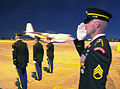 At Yokota Air Base, US Army Honor Guard salute the arrival of a C-130 Hercules from Korea 011003-F-TR874-008.jpg
