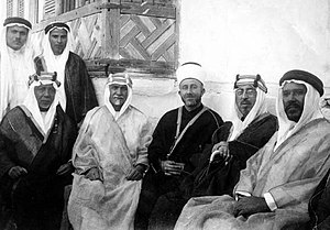 Hashim al-Atassi - Al-Atassi (second person seated from the left) in a visit to Saudi Arabia in the early 1930s wearing a Bedouin garb. To his left are Mohammad Amin al-Husayni, the Grand Mufti of Jerusalem and Emir Shakib Arslan, an Arab nationalist philosopher from Lebanon