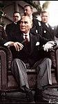 Atatürk bir koltukta otururken.jpg