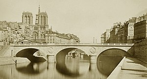 Auguste Hippolyte Collard - A photograph of Pont Saint-Michel taken by Auguste Hippolyte Collard in 1859, two years after its construction.
