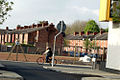 Avenues and Old Bus Depot site from Beresford Street in Moss Side, Manchester, UK.jpg