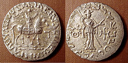Silver coin of the Indo-Scythian king Azes II (r.c. 35–12 BCE). Buddhist triratna symbol in the left field on the reverse.