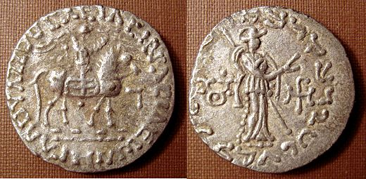 Silver coin of Indo-Scythian King Azes II (ruled c. 35-12 BC). Buddhist triratna symbol in the left field on the reverse AzesIITriratna.jpg