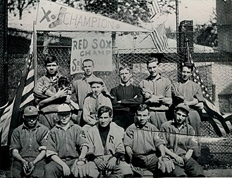 Babe Ruth - Ruth (top row, left, holding a catcher's mitt and mask) at St. Mary's, 1912