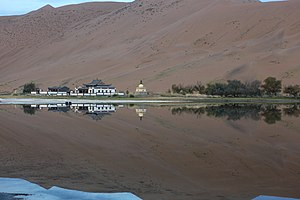 Badain Jaran Desert - The Badain Jaran Temple in September alongside its lake