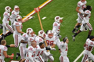 Wisconsin Badgers football - Badgers celebrating their win by carrying Paul Bunyan's Axe around the stadium after the 2009 game
