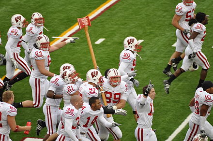 Badgers celebrate their win by carrying Paul Bunyan's Axe around Camp Randall after the 2009 game. Badgers carrying Paul Bunyan's Axe.jpg
