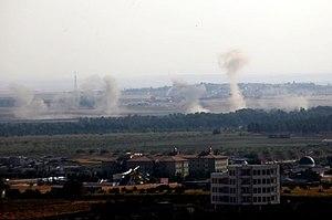 Barış Pınarı Hârekatı sonrası Resulayn (Serêkanî) bombalanıyor.jpg